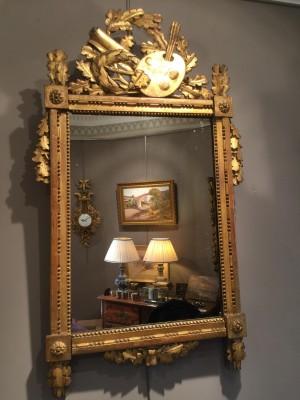 Miroir d'époque Louis XVI en bois doré.