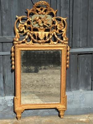 Miroir d'époque Louis XVI-Directoire en bois dorè.