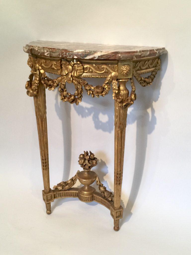 Console d'époque Louis XVI en bois doré.