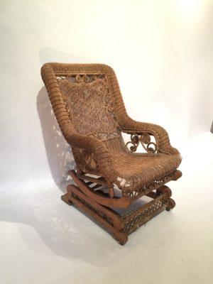 Rocking-chair en rotin d'époque fin XIX ème siècle.