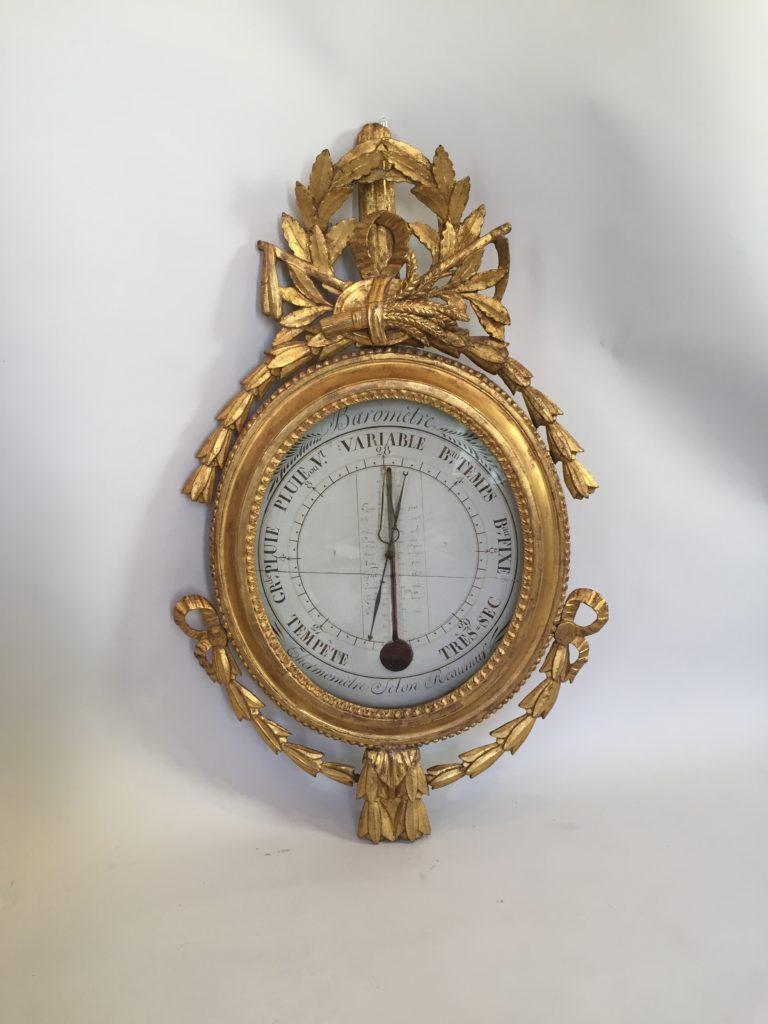 Barometre d'époque Louis XVI en bois doré.