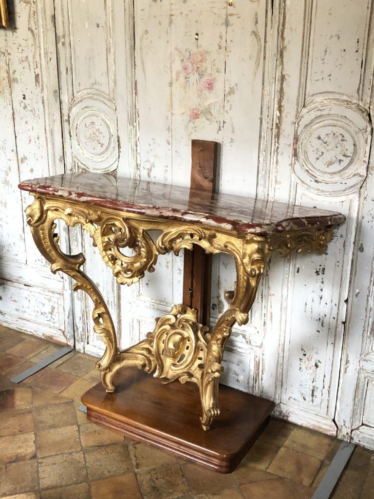 Console d'époque Louis XV en bois doré.